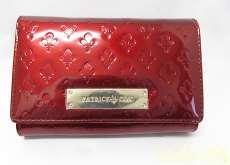ロゴプレート二つ折財布 PATRICKCOX