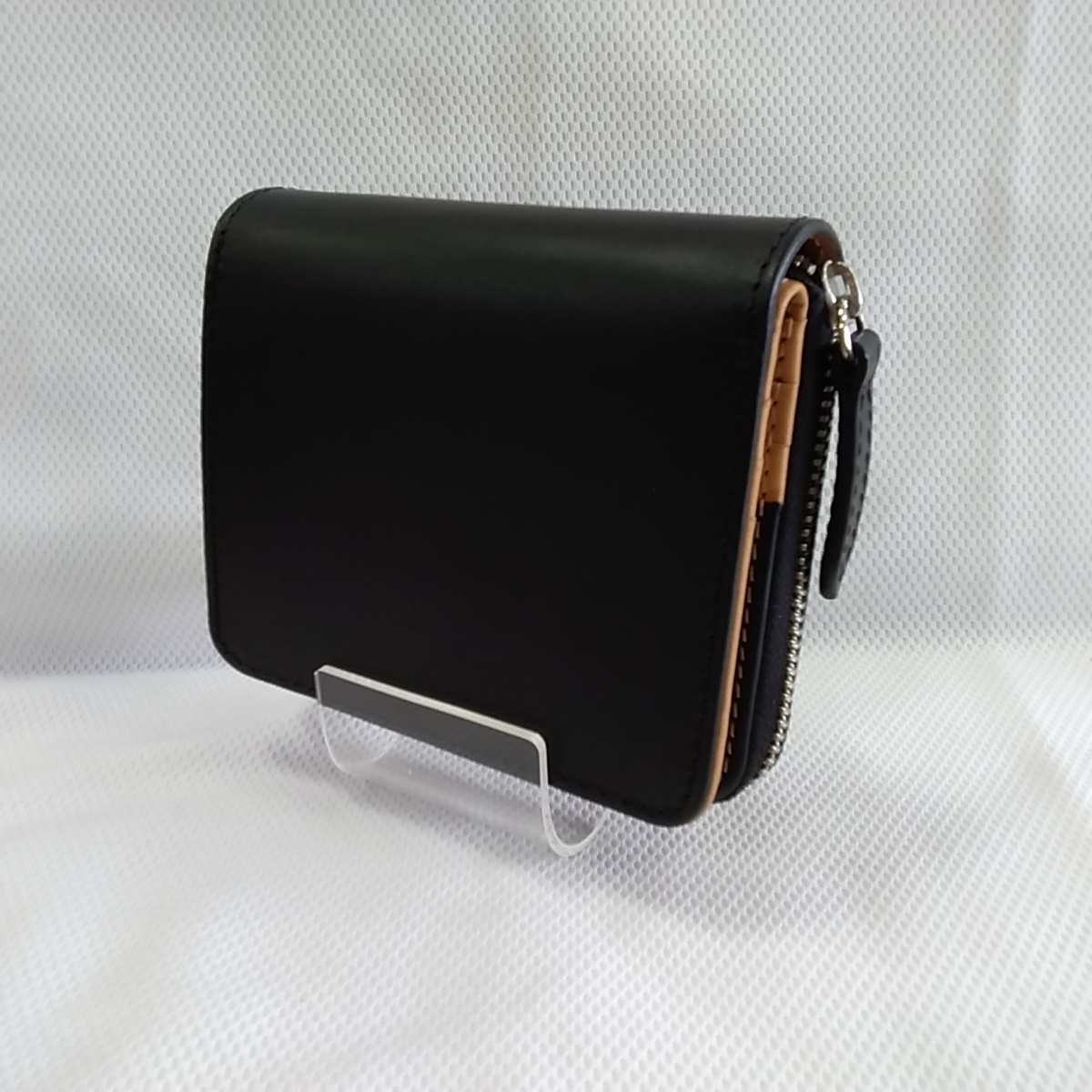 レザー二つ折り財布|PELLE CONCIATA AL VEGETALE IN